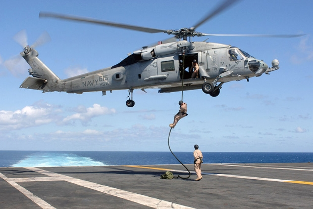 nance_disposal_technicians_assigned_to_Explosive_Ordnance_Disposal_Mobile_Unit_%28EODMU%29_2%2C_Det__26%2C_conduct_a_fast_rope_exercise_from_an_HH-60H_Seahawk.jpg