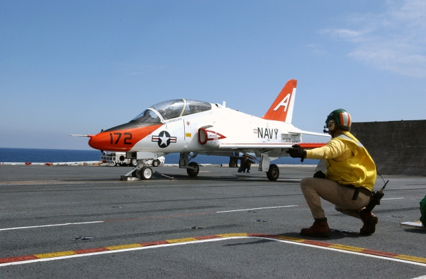 US_Navy_030314-N-4768W-051_A_T-45C_Goshawk_receives_the_launch_signal_from_a_shooter_on_the_flight_deck_of_USS_John_C._Stennis_(CVN_74).jpg