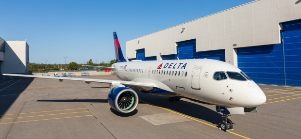 First-Delta-A220-rolls-out-of-paintshop-in-Mirabel.jpg