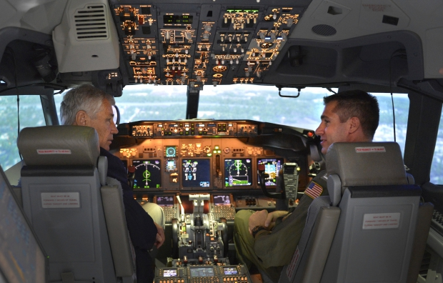 Secretary_of_Defense_Chuck_Hagel,_left,_sits_in_the_cockpit_of_a_P-8_Poseidon_aircraft_flight_simulator_as_he_visits_the_Patrol_Squadron_30_training_center_at_Naval_Air_Station_Jacksonville,_Fla.,_on_July_16,_2_130716-D-NI589-1382.jpg